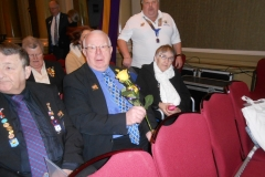 Lion Barry with a yellow rose in memory of Lion Roy Bolland who has been called to Higher Lionistic service.