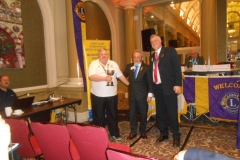 Lion President Terry receiving the trophy for Travelling Lion from International Director Lion George & District Governor Lion Nigel.